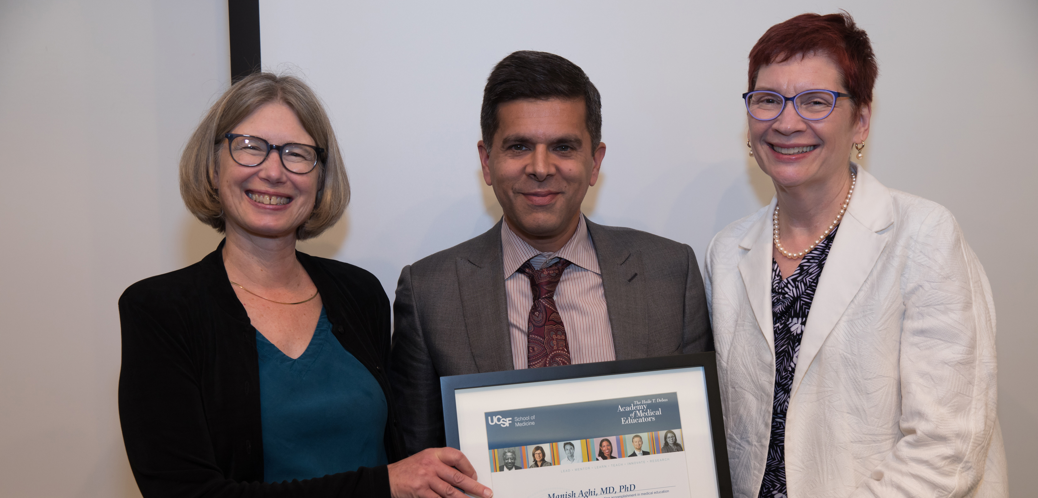 Manish Aghi (center) is inducted into the Academy on September 26, 2018