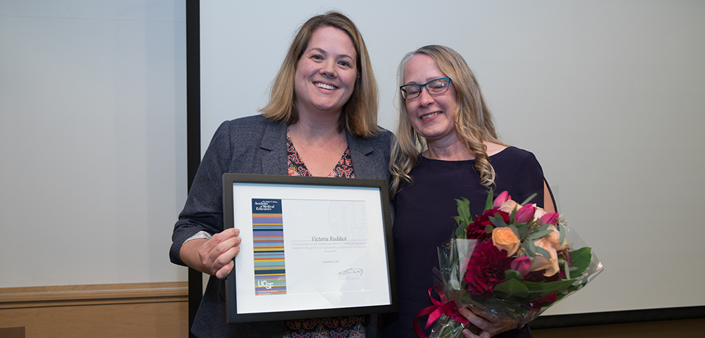 Stacy Sawtelle, MD presents Victoria Ruddick with the Award for Exceptional Service in Medical Education
