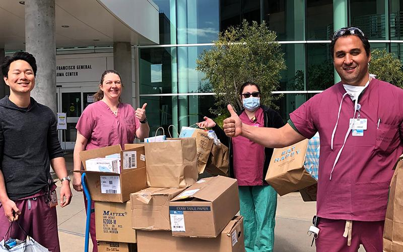 UCSF health care workers receive a donation of personal protective equipment from medical students